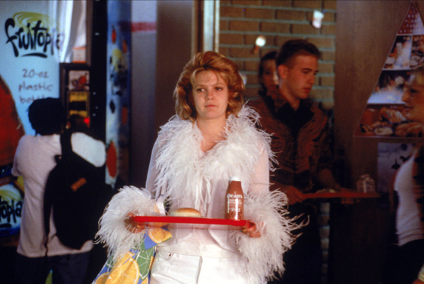 Still from cafeteria scene in film NEVER BEEN KISSED, of protagonist Julia dressed in outrageous clothes, wondering with whom she should sit at lunch.
